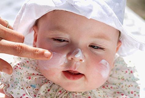 PRinc photo of baby with sunscreen thumb